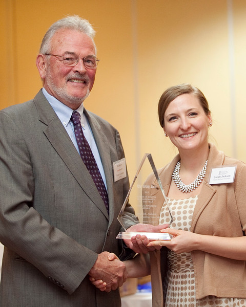 Daily Item publisher Peter Gamage presents the Businesswoman of the Year award for small business to Sarah Jackson of Sarah J Consulting at the annual North of Boston Businesswomen of the Year awards at the Holiday Inn in Peabody on Wednesday, October 23. Item Photo / Angela Owens.