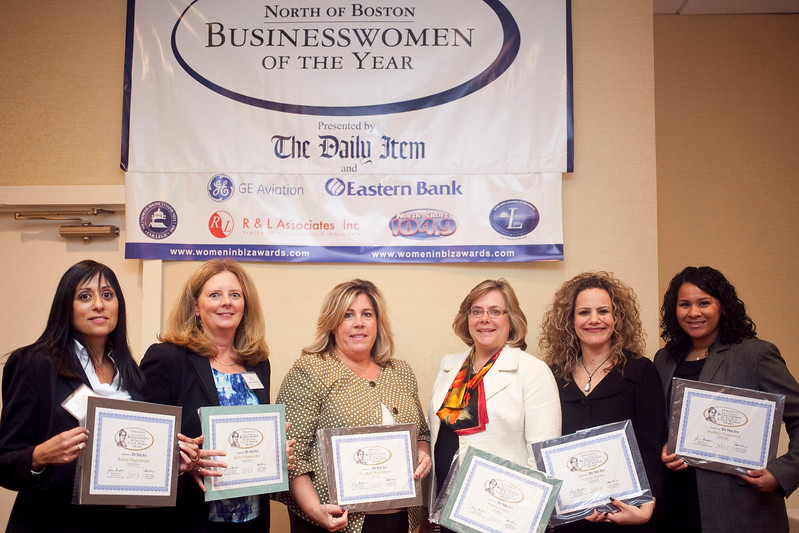 Nominees for the Businesswoman of the Year award for large business, from left, Karen Oppenheim, Beth Schumacher, Jo Mary Koopman, Nancy Stager, Teresa Sarno, and Ivelisse Gonzalez, pose for a photo at the annual North of Boston Businesswomen of the Year awards at the Holiday Inn in Peabody on Wednesday, October 23. Item Photo / Angela Owens.