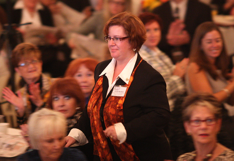 Gayla Bartlett, from Cranney Self Storage, Inc. Danvers, heads to the stage to accept her Lydia Pinkham Award in the Large Business Category at the 12th Annual North of Boston Business Women of the Year Award ceremony held at the Nahant Country Club on October 25. Photo by Owen O'Rourke