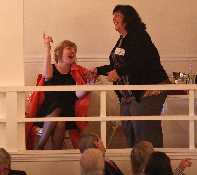 Karyan Needel from the Daily Item, right, gives one of the raffle prizes to one of the guests at the 12 Annual North of Boston Business Women of the Year awards ceremony held at the Nahant Country Club on October 25. Photo by Owen O'Rourke