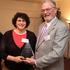 Stacy Ames of Falmer Thermal Spray, left, accepts the Liydia Pinkham Awards in the Intermediate Business category from Peter Gamage, President and Publisher of the Daily Item at the 12th Annual North of Boston Business Women of the Year Awards held at the Nahant Country Club on October 25. Photo by Owen O'Rourke