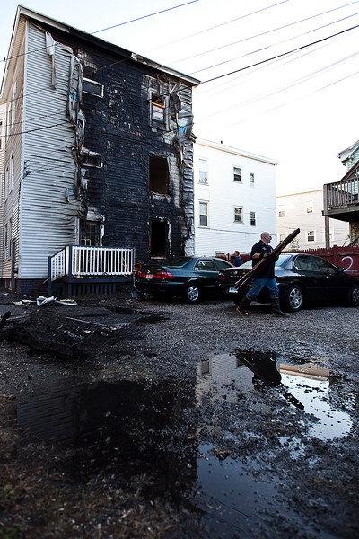 Debris is strewn on the ground and siding is scorched on the back of the house at 589-591 Summer Street after a fire on Thursday, October 25. Item Photo / Angela Owens.