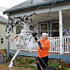 Lynn, 131 Woodlawn Street. Larry Lawless and his Halloween decorations.  Larry tweeks a spider.