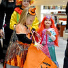 "Saugus, Square One Mall. Halloween Boo Bash.  Gianna Bennett, the witch in the foreground from Winthrop, Julianna Taylor, as ""Ariel"" is from Saugus, and in the back is Adrianna Pescione, as a clown, from Saugus.  They are collecting candy from the many stores that were handing it out during this event."