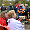 "Lynn, Barkland Dog Park, Halloween dog costume contest. The judge of the contest Mayor Judith Kennedy and Iris Cyr (not a judge)  on the right holding ""Benji"" , are watching the dogs as they pass by."