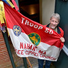 Nahant.  Doug Frauenholz, scout master, with the flag for troop 50.