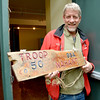Nahant.  Doug Frauenholz, scout master, holds an old wooden sign for troop 50.