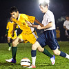 Classical's Angel Canales (3) and Swampscott's Ray Rosa (13) vie for the ball during their game at Swampscott High School on Tuesday, October 2. Item Photo / Angela Owens.