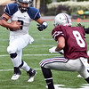 Swampscott's Desmond Wilhelmsen (2) attempts to carry the ball around Lynn English's Anthony Delacruz (8) during their game at Manning Field on Friday, October 4. Item Photo / Angela Owens.