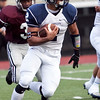 Swampscott's Desmond Wilhelmsen (2) carries the ball during their game against Lynn English at Manning Field on Friday, October 4. Item Photo / Angela Owens.