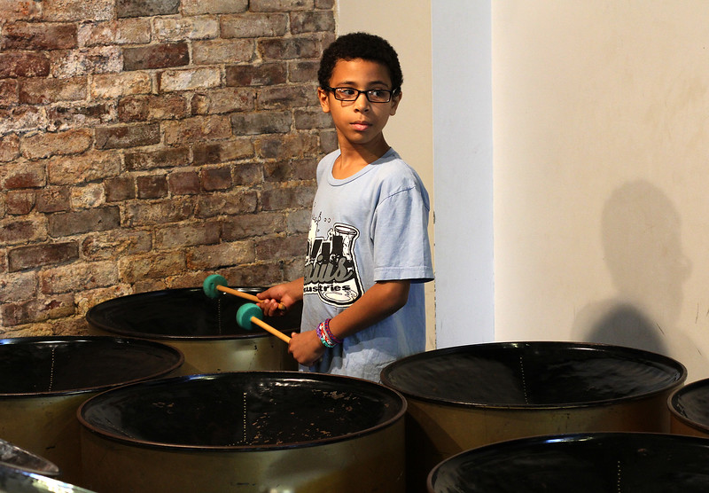 Jaydon Walker, a member of the Youth Steel Orchestra, gets ready to play at the open house and workshop held at LynnArts on Saturday. Anyone interested in joining should call Muriel Clement at 617-529-8686 or e-mail her at muriel.clement59@gmail.com Photo by Owen O'Rourke
