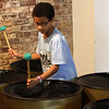 Jaydon Walker, a member of the Youth Steel Orchestra, plays at the open house and workshop held at LynnArts on Saturday. Anyone interested in joining should call Muriel Clement at 617-529-8686 or e-mail her at muriel.clement59@gmail.com Photo by Owen O'Rourke