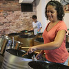 Shyanne Permell-Smith, a member of the Youth Steel Orchestra, plays at the open house and workshop held at LynnArts on Saturday. Anyone interested in joining should call Muriel Clement at 617-529-8686 or e-mail her at muriel.clement59@gmail.com Photo by Owen O'Rourke