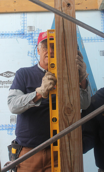 Dave Johnson was one of the many people working on the Habitat for Humanity project at 6 Grover Street in Lynn on Saturday. Photo by Owen O'Rourke