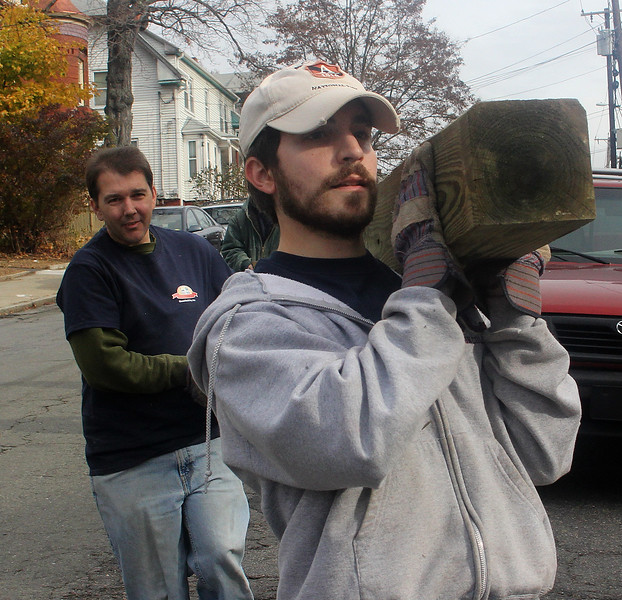 Jason Gray, left, and Peter DeLuca, right, were just two of the many people who worked on the Habitat for Humanity projecdt on Grover Street in Lynn on Saturday. Photo by Owen O'Rourke