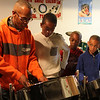 Justin A. Petty Sr., left, gives a quick workshop to Donavan Payne, Omarion Dor, and Justin Petty Jr. Saturday at the Youth Steel Orchestra open house and workshop at LynnArts. Anyone interested in joining should call Muriel Clement at 617-529-8686 or e-mail her at muriel.clement59@gmail.com. Photo by Owen O'Rourke