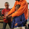 Justin A. Petty Sr., right, gives a quick workshop to Omarion Dor, left, and Justin Petty Jr., right, Saturday at the Youth Steel Orchestra open house and workshop at LynnArts. Anyone interested in joining should call Muriel Clement at 617-529-8686 or e-mail her at muriel.clement59@gmail.com. Photo by Owen O'Rourke