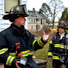Lynn.  Captain John Thorpe, training instructor, gives a rundown on procedure before entering the house.  Rt. is Estarlo Abreu, Lynn firefighter and Jovan Ector. In the background is another house that has been used for drills.