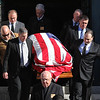 The body of Antonio Marino being carried from Holy Family Church in Lynn after funeral services today. Photo by Owen O'Rourke