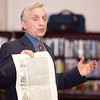 Kenneth Gloss, owner of the Brattle Book Shop, talks about old and rare books at the Lynn Public Library on Thursday, November 21. Item Photo / Angela Owens.