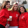 From left to right: Amanda Dente, Emily Couillard, and Nancy Iacopino supporting the seniors playing in the powder puff football game at Saugus High School on Wednesday, November 21. Photo by Owen O'Rourke