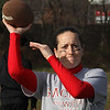 Cecelia Baston,the quarter back for the staff, warming up prior to the start of the Saugus High School Powder Puff game held on Wednesday, November 21. Photo by Owen O'Rourke