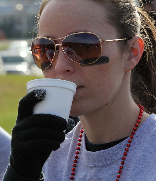 Kate Payne drinks some hot chocolate before the start of the powder puff game between the staff, which she a part of, and the  seniors at Saugus High School on Wednesday, November 21. Photo by Owen O'Rourke