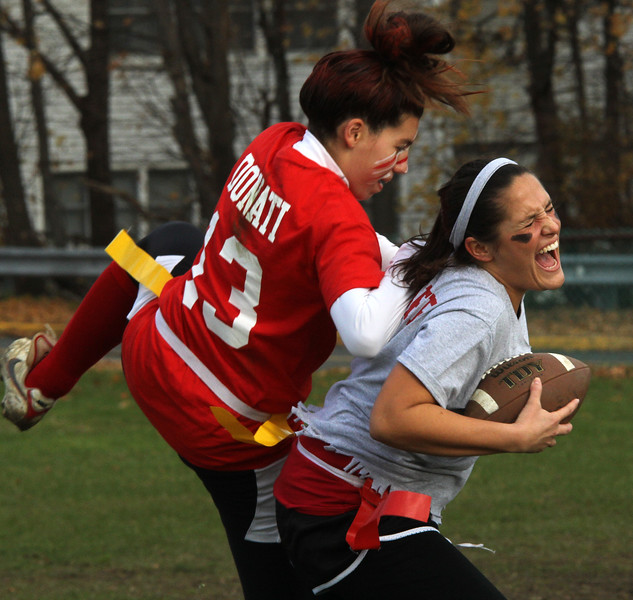 kara Donati, left, a senior at Saugus High School, tries to prevent Bethany Larsen, right, a member of the staff at Saugus High School, from catching a pass during the powder puff game held there on Wednesday, November 21. Photo by Owen O'Rourke