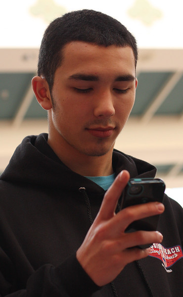 Jared Brogan uses the app shoppick at the Square One Mall on Black Friday.  Photo by Owen O'Rourke