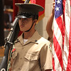 Calvin Kem, part of the four member color guard Marine Corp Jr. ROTC at English High, posting the colors at the Veterans Day ceremony at Breed Middle Schoool today. Photo by Owen O'Rourke
