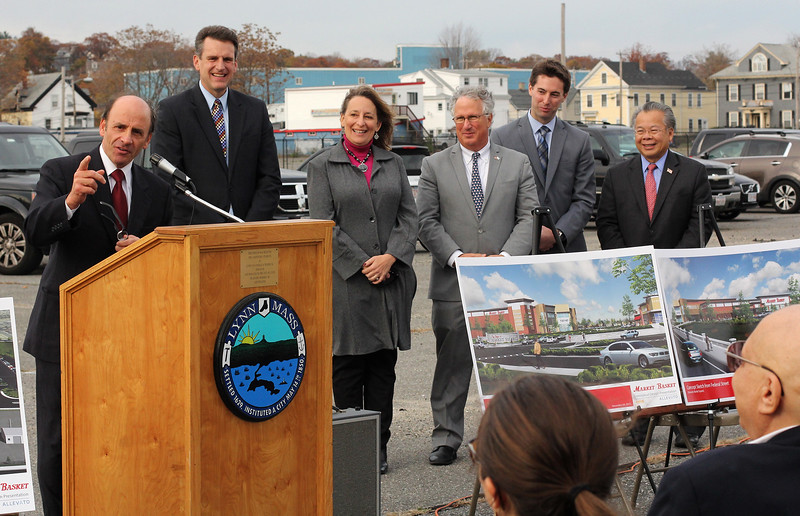 Arthur DeMoulas says a few words at the state grant for infrastruure ceremony at the the old General Electric building on Federal Street as Jay Ash, State Housing and Economic Development Secretary, State Rep Lori Ehrlich, State Senator Thomas McGee, State Rep. Bredan Crighton, and State Rep Donald Wong look on. Photo by Owen O'Rourke