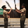 Calvin Kem, left, and Reny Beltran, right, of the Marine Corp Jr. ROTC drill team from Englsih High School, perfroming a drill routine at the Veterans Day ceremony at Breed Middle Schooll today. Photo by Owen O'Rourke