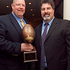 St. Mary's coach Matt Durgin, recipient of the Coach of the Year award, left, poses for a photo with Curry College football coach Skip Bandini, at the Daily Item All Star banquet at the Hilltop Steakhouse on Monday, December 10. Item Photo / Angela Owens.