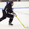St. Mary's Connor Parent takes the puck across the ice during hockey practice at Connery Rink on Monday, December 10. Item Photo / Angela Owens.
