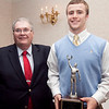 Steve Krause poses for a photo with Brendan Flaherty, winner of the Daily Item Player of the Year award, at the Daily Item All Star banquet at the Hilltop Steakhouse on Monday, December 10. Item Photo / Angela Owens.
