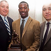 St. John's Prep football coach Jim O'Leary, left, and Paul Halloran of Grant Communications, left, present the Agganis Foundation Offensive Player of the Year award to Johnathan Thomas at the Daily Item All Star banquet at the Hilltop Steakhouse on Monday, December 10. Item Photo / Angela Owens.