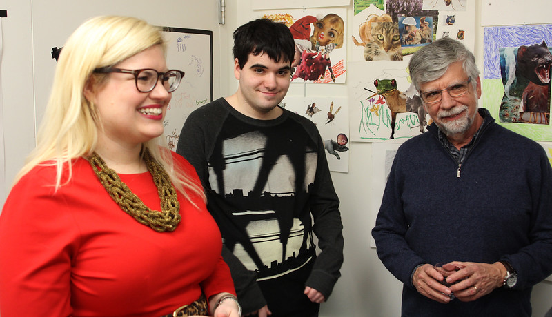 Allison Mitchell, left, artist Paul Ouellette, and Jim Ouellette, right, enjoy the ArcWorks art exhibit in Peabody.