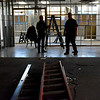 lft. Robert Tucker, President of the Board of Directors of Lynn Community Television and rt. Sean Donahue, Director of Operations of LCTV, look over the construction at their new site at 181 Union Street.