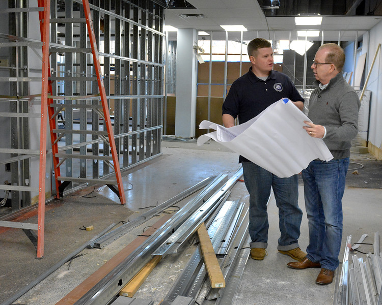 lft. Sean Donahue, Director of Operations at Lynn Community Television and rt. Robert Tucker, President of LCTV, look over the plans for the new studio and offices at 181 Union Street.