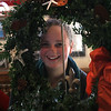 Dana McKinnon-Tucker surrounded by one of the many Boxwood wreaths that was for sale at her counter the 12th annual Nahant Holiday Fair on Saturday at the Town Hall.run by the Nahatn Womens Club, all money raised goes toward scholarships for Nahant kids. Photo by Owen O'Rourke
