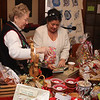 Patty Demit, left, and Maureen Locke, right, work the table out front at the 12th annual Nahant Holiday Fair on Saturday. Photo by Owen O'Rourke