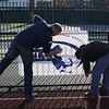 Rich Avery, left, and Brian Billingsley prepare Manning Field for Saturday's game.