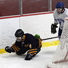 Lynnfield High School vs Danvers High School at the Kasabuski Holiday Classic. M. Look of Lynnfield pushes the puck out from behind the net after losing his stick. Photo by Owen O'Rourke