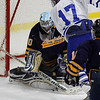 Lynnfield High School vs Danvers High School at Kasabuski Holiday Classic. Goalie Joseph Bassi stops A J conto, 17 of Danvers High from scoring in first period action. Photo by Owen O'Rourke