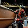 Captain of the Glover Regiment, Seamus Daly, Marblehead, checks the condition of the longboat that will be used for a reenactment of the crossing of the Delaware on Christmas night in 1776. It occurs this coming weekend in Marblehead harbor.