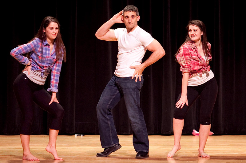"""Paul Korchari, a science teacher at Swampscott High School, dances to """"Man I Feel Like a Woman"""" by Shania Twain, with students Noelle Saulnier and Stef Borneman, at the Swampscott High School """"Dancing with the Staff"""" event on Thursday, Feb. 9. Item Photo / Angela Owens."""