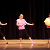 """Lauren Skelton, a science teacher, dances with students Victoria Laurano and Alexis Santella, to """"Wannabe"""" by the Spice girls at the Swampscott High School """"Dancing with the Staff"""" event on Thursday, Feb. 9. Item Photo / Angela Owens."""