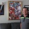 Mike Eruzione in his home in Winthrop. The Olympic tourch in on the wall to the left. Photo by Owen O'Rourke
