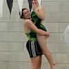 Briana Silva hoists Sarah Sirois after her diving win