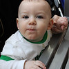 Face of a racer. Vinny Noyes, eight months old of Lynn, competed in the second heat in the Diaper Derby at the Square One Mall in Saugus on February 25. Photo by Owen O'Rourke